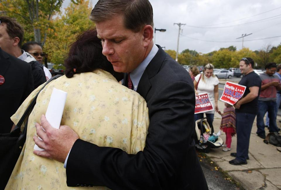 Martin J. Walsh and supporter Delia Baez of Jamaica Plain hugged after he released his plan outside English High.