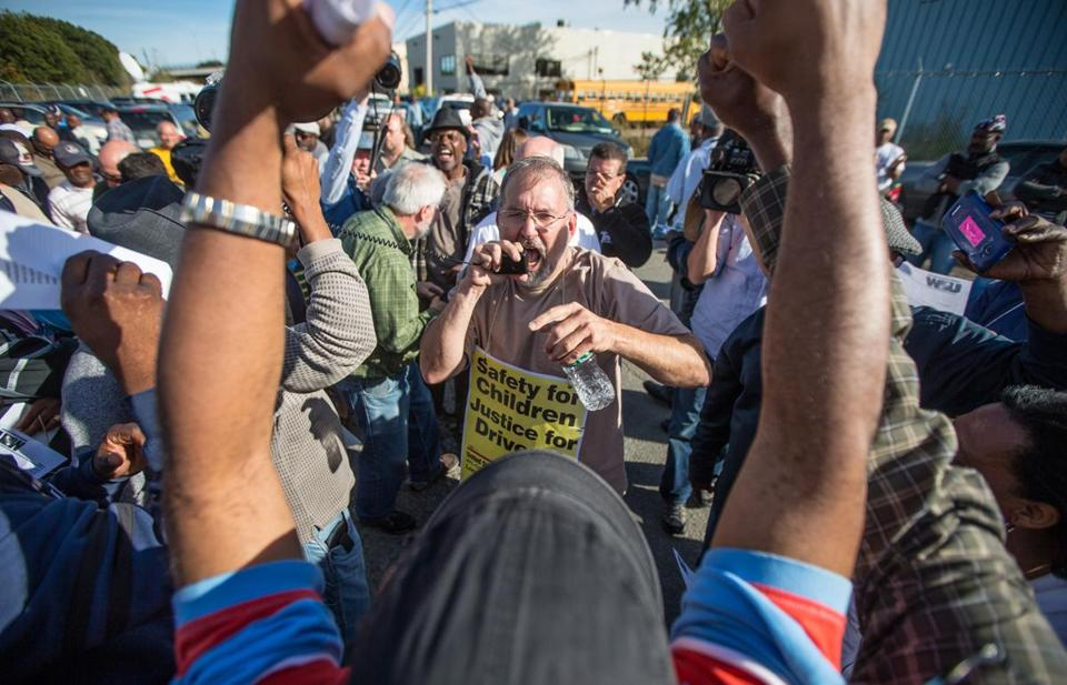 "Stevan Kirschbaum, a school bus driver and a union leader, rallied co-workers on Tuesday outside the Readville bus yard. Mayor Thomas M. Menino has called Kirschbaum a ""bully."""