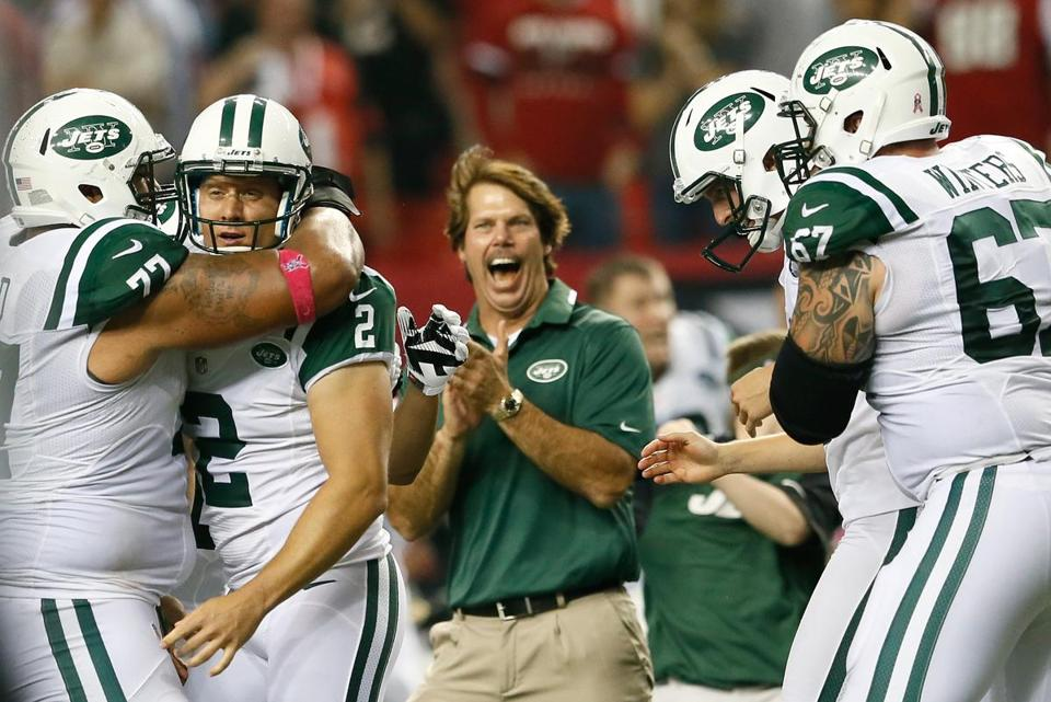 Jets players congratulate Nick Folk (2) on his game-winning kick.