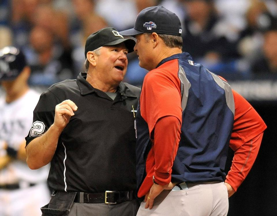 John Farrell talked with umpire Dana DeMuth during the fourth inning of Game 3.