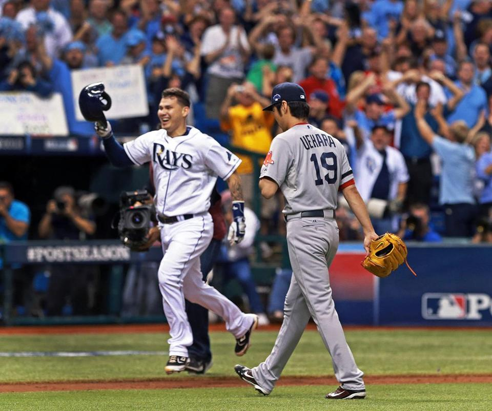 Jose Lobaton crossed paths with Koji Uehara after delivering a walkoff home run for the Rays.