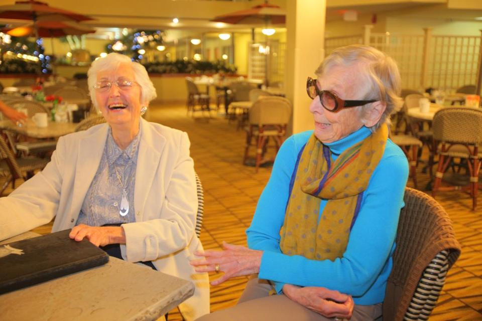 Jeanne (Herwitz) Burmon (left) and Marilyn (Morrill) Kudisch discuss the upcoming Brookline High School class of 1943 reunion.