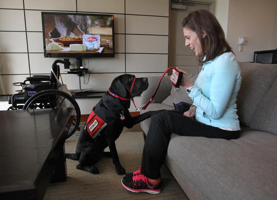 Jessica Kensky with Rescue, the black Lab service dog she was given by NEADS/Dogs for Deaf and Disabled Americans.