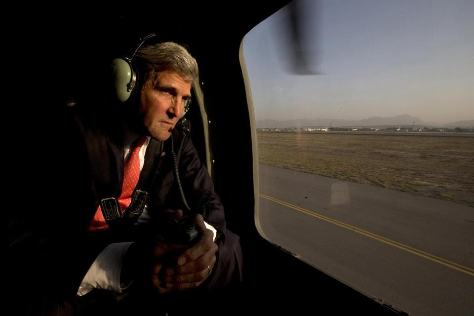 Secretary of State John Kerry aboard a helicopter after arriving for an unannounced visit in Kabu on Friday.