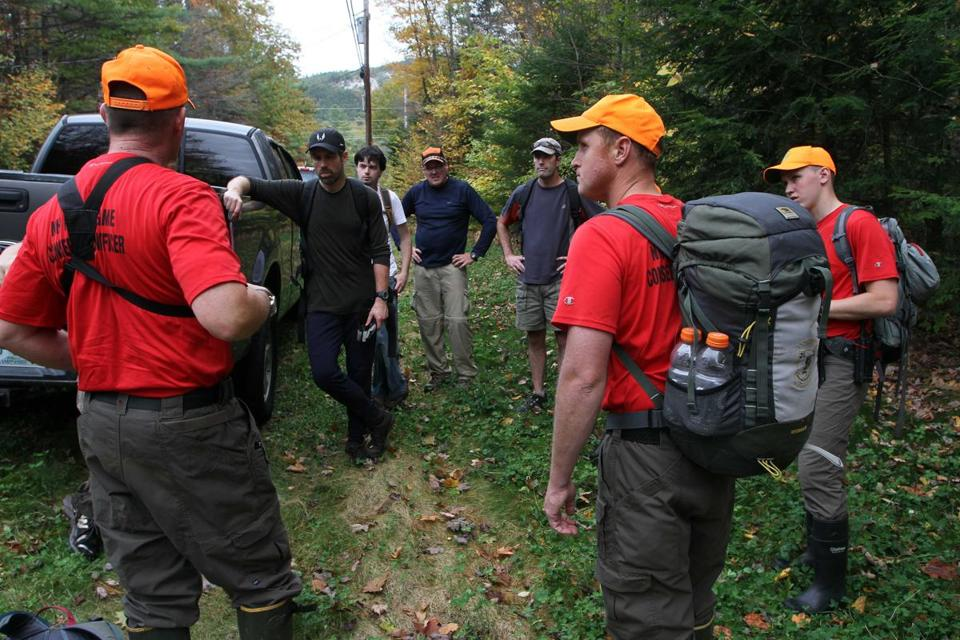 New Hampshire Fish and Game personnel and volunteers prepared to search a wooded area in Conway, N.H., Friday for Abigail Hernandez, who disappeared after school Wednesday. Her 15th birthday is Saturday.