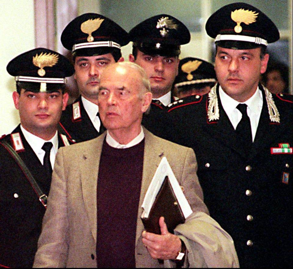Erich Priebke, shown entering a court in Rome, was extradited from Argentina in 1995.