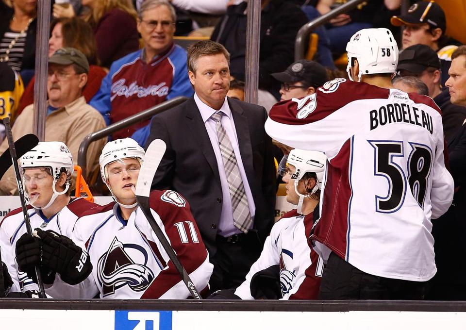 Avalanche coach Patrick Roy spoke with Patrick Bordeleau during Thursday's game.