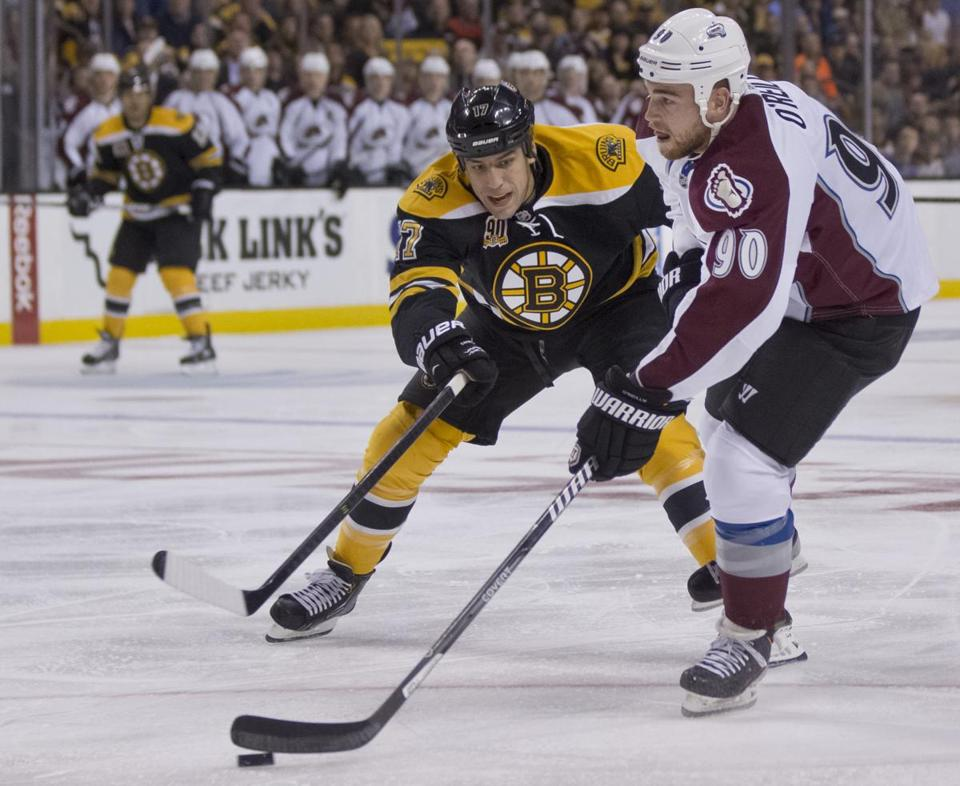 Ryan O'Reilly (right) had control of the puck as the Bruins' Milan Lucic put on the pressure during the first period.