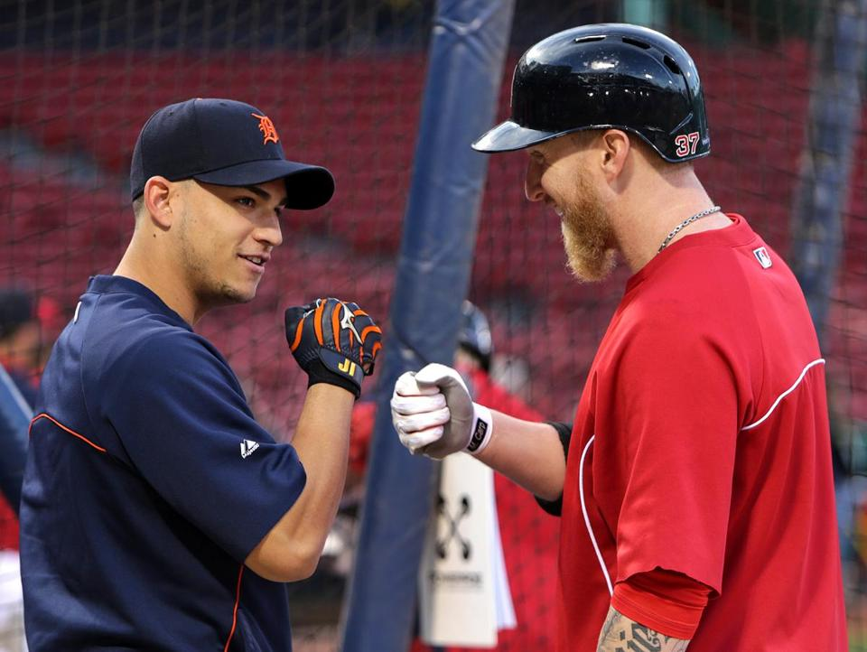 Jose Iglesias, left, greeted Mike Carp on Friday.