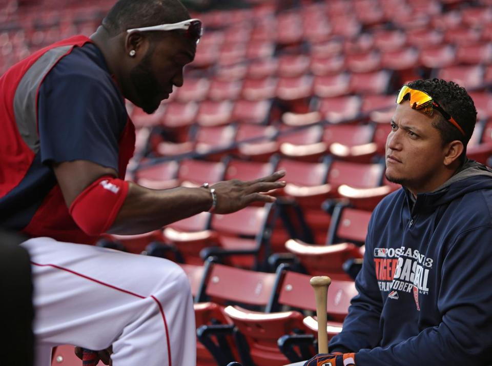 David Ortiz spoke with the Tigers' Miguel Cabrera during team workouts on Friday.