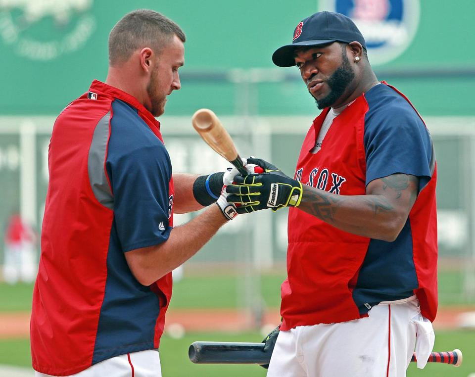 Will Middlebrooks gets some hitting tips from David Ortiz during the Red Sox' workout Thursday at Fenway Park.