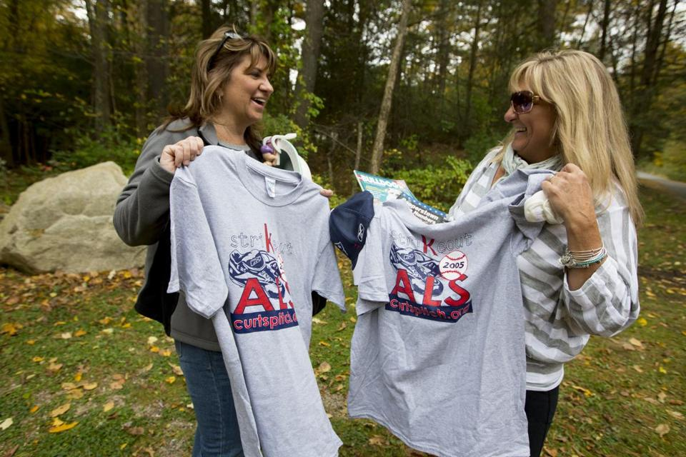 Michelle Daszkiewicz, of Norfolk (left), and Debbie McElroy, of Wrentham, showed off the t-shirts that they bought at Curt Schilling's estate sale.