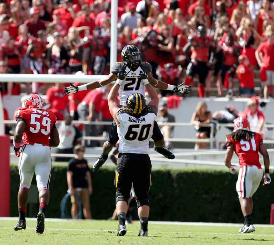 Wideout Bud Sasser (21) celebrates his 40-yard TD pass that helped seal a win vs. Georgia.