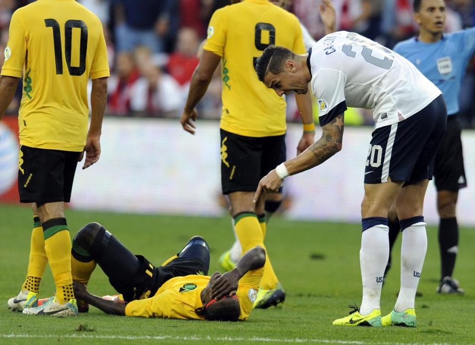 US defender Geoff Cameron (right) admonishes Darren Mattock after the Jamaican forward seemed to act hurt after a collision.