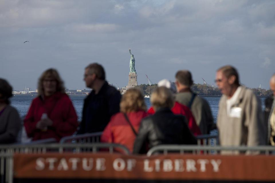 Tourists waited to embark on a visit the Statue of Liberty, which reopened Sunday.