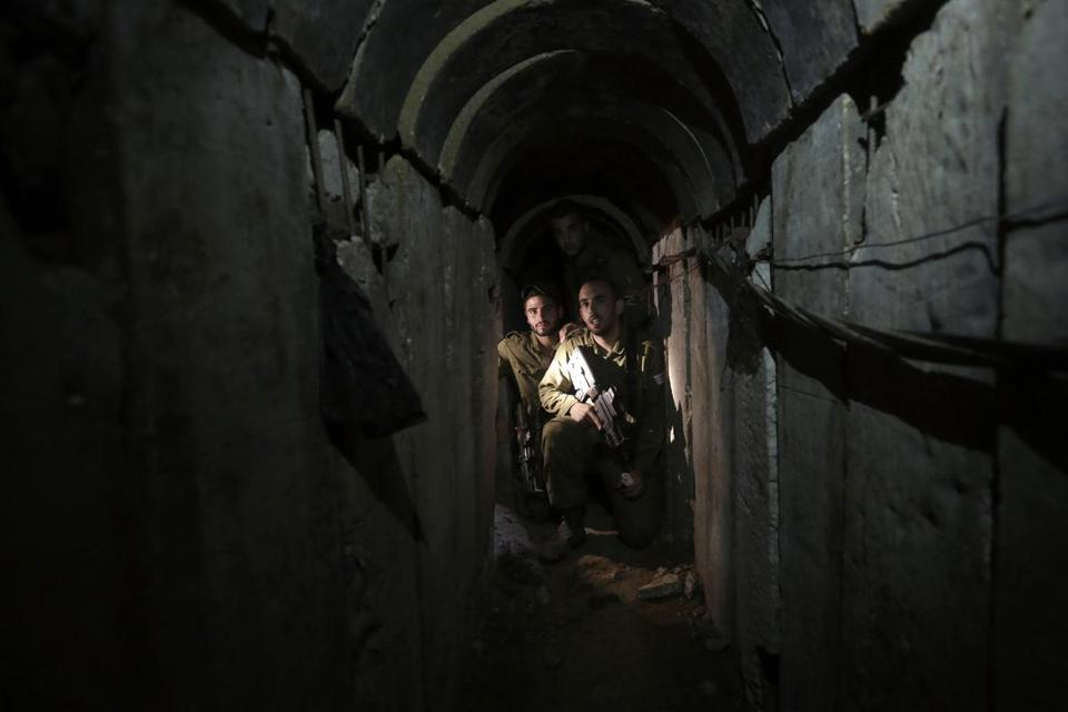 Israeli soldiers walked through a mile-long tunnel beneath the Gaza border on Sunday. The tunnel, built at a depth of 60 feet, led to an opening near a communal farm in Israel.