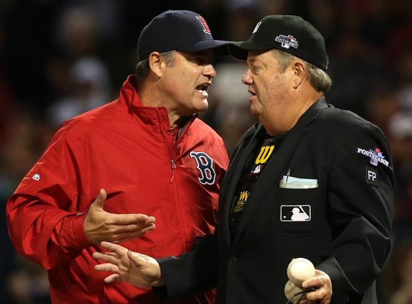 Manager John Farrell has an animated discussion with umpire Joe West, who had an eventful night behind the plate.