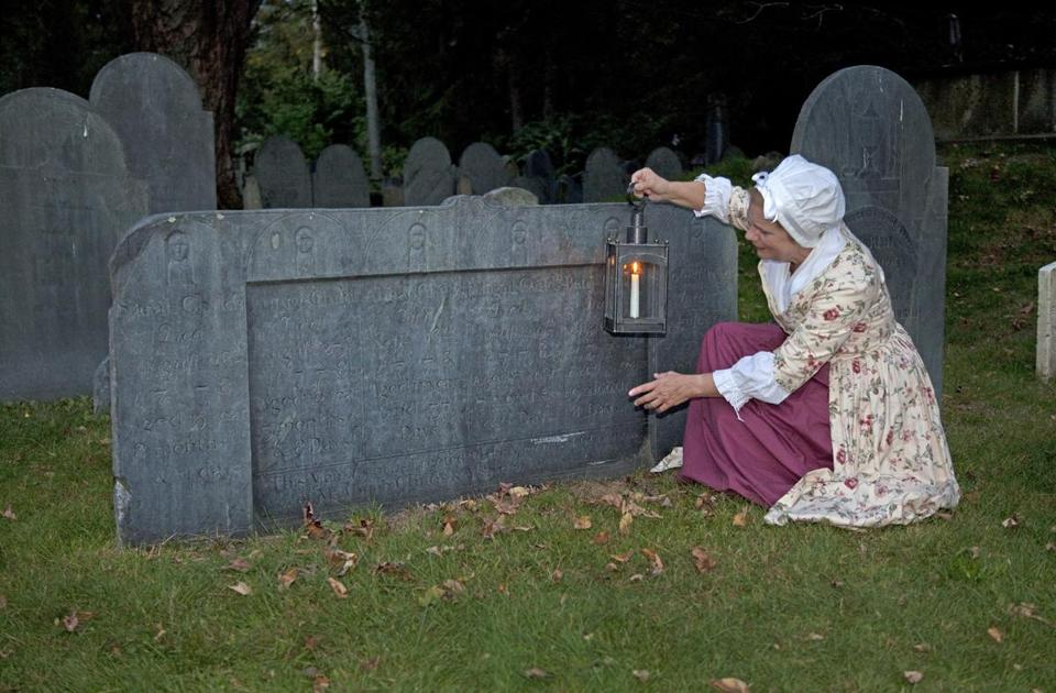 Jane Morse of the Lexington Historical Society haunts the Old Burying Ground during the annual Halloween walk.