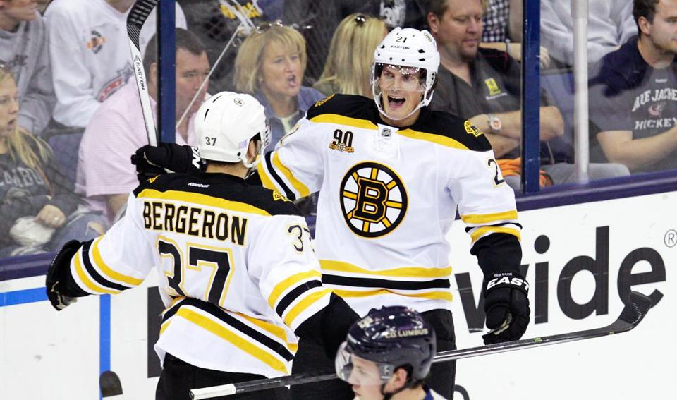 Loui Eriksson celebrates his first goal as a member of the Bruins, a third-period strike against the Blue Jackets, with teammate Patrice Bergeron.