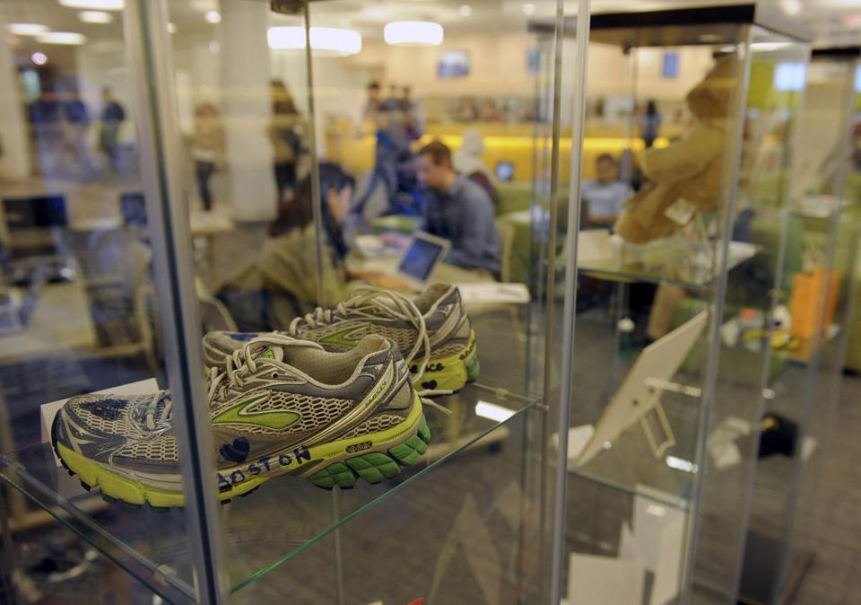 Items from the memorial in Copley Square in honor of the Marathon bombing victims are on display in an exhibit at Northeastern University.  (Essdras M Suarez/ Globe Staff)/