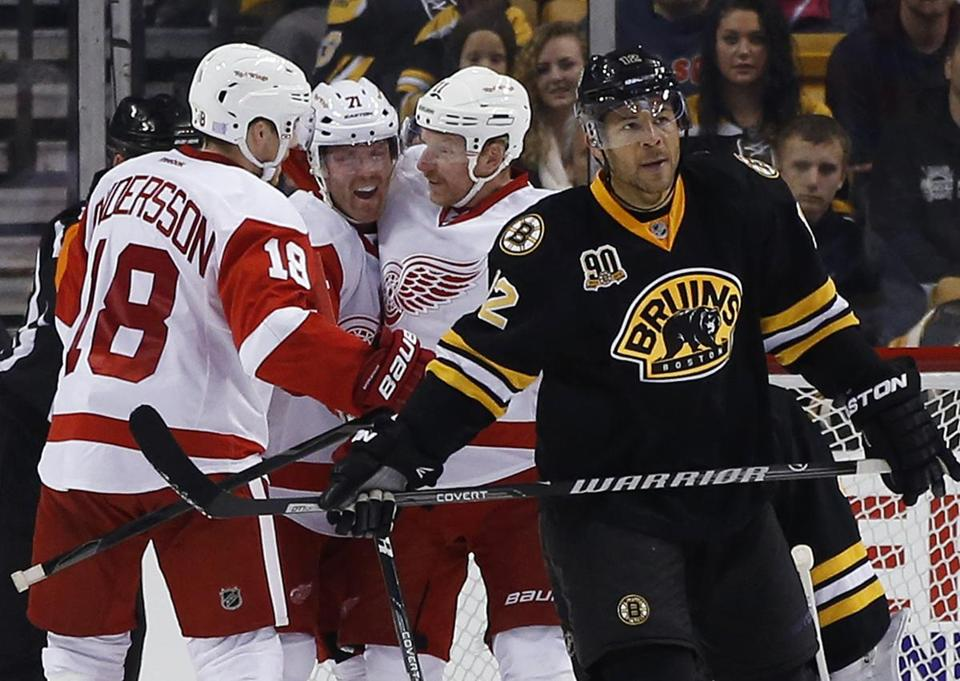 Jarome Iginla skated away as the Red Wings celebrated a goal Monday.