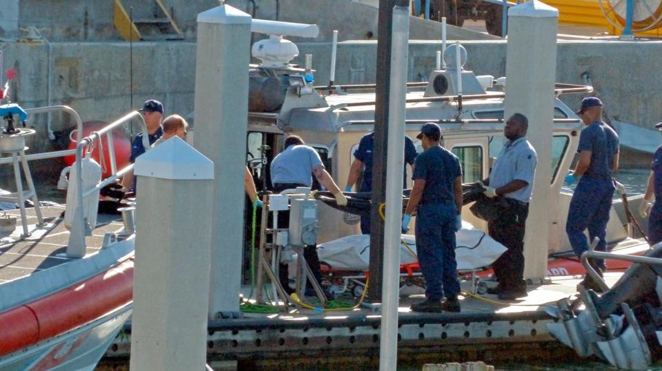Coast Guard workers found four bodies and one survivor underneath the boat.