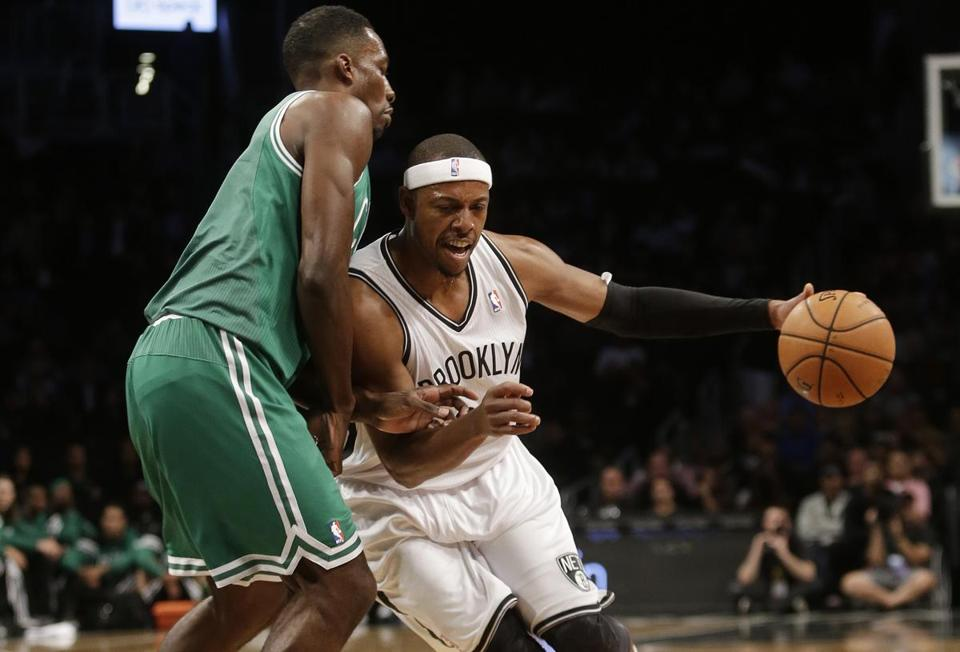 Paul Pierce, now of the Brooklyn Nets, handled the ball against Jeff Green during a pre-season game in New York.