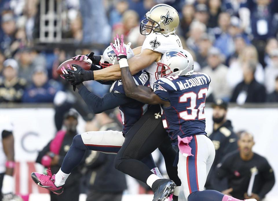 The Patriots held Saints tight end Jimmy Graham (center)  without a catch on Sunday.