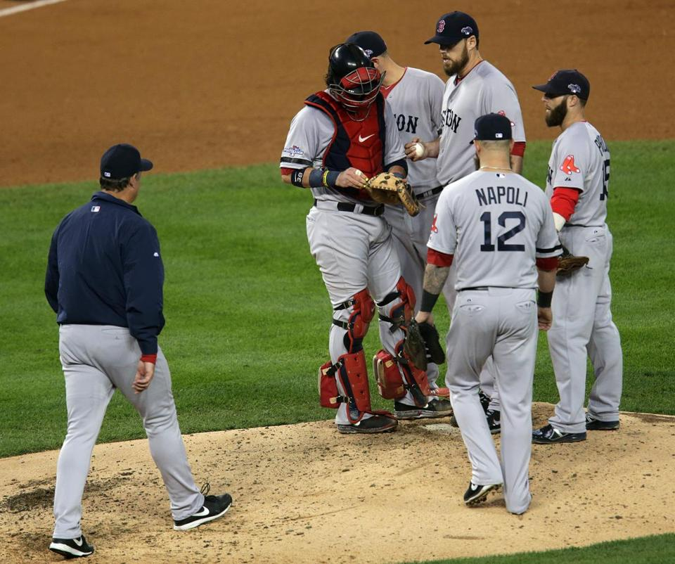 Red Sox manager John Farrell, left, made a surprising move to lift John Lackey after just 97 pitches.