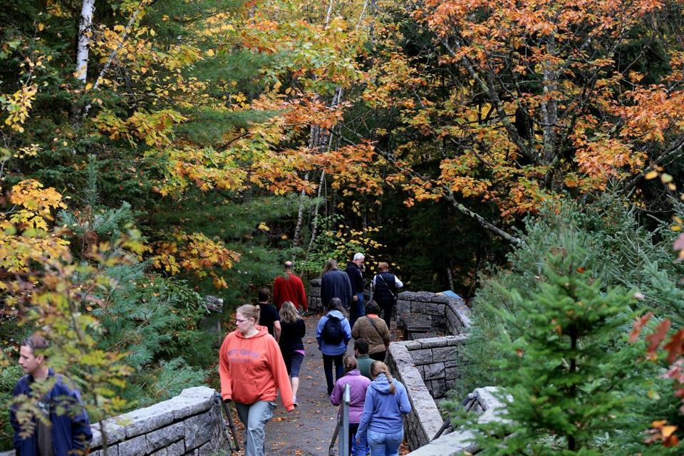 Acadia National Park, a big destination for leaf-peepers, was open for business Thursday after being closed for weeks.