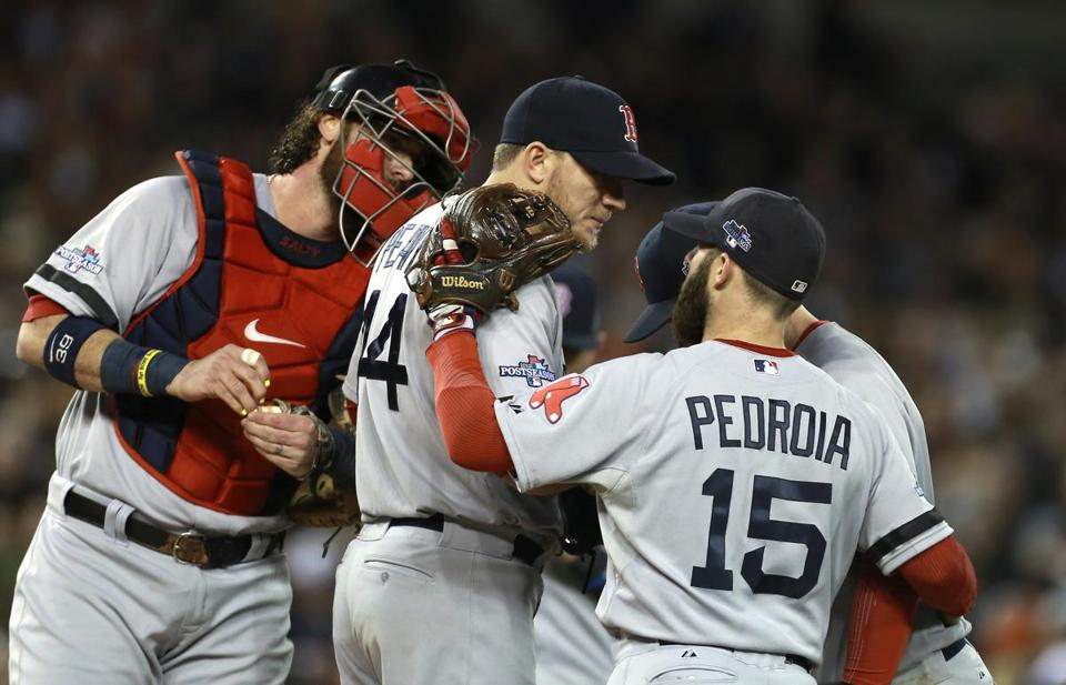Teammates gathered to support Jake Peavy during the Tigers' 5-run second inning.