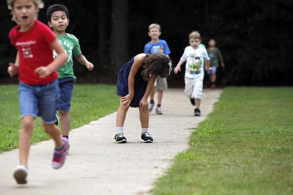 Elementary students in Georgia ran on a track in 2013. Experts say physical activity and healthy diets are key to preventing childhood obesity.