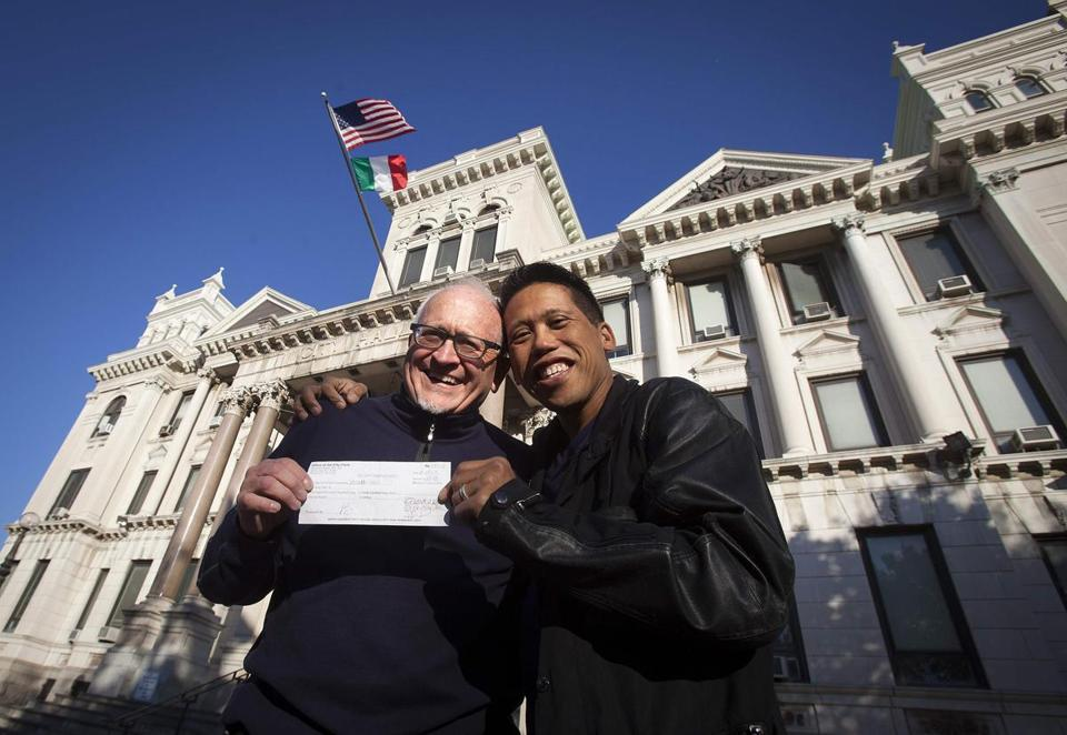 David Gibson (left) and Rich Kiamco displayed their wedding license receipt Friday in Jersey City after the state's top court ruled same-sex marriages can begin Monday.