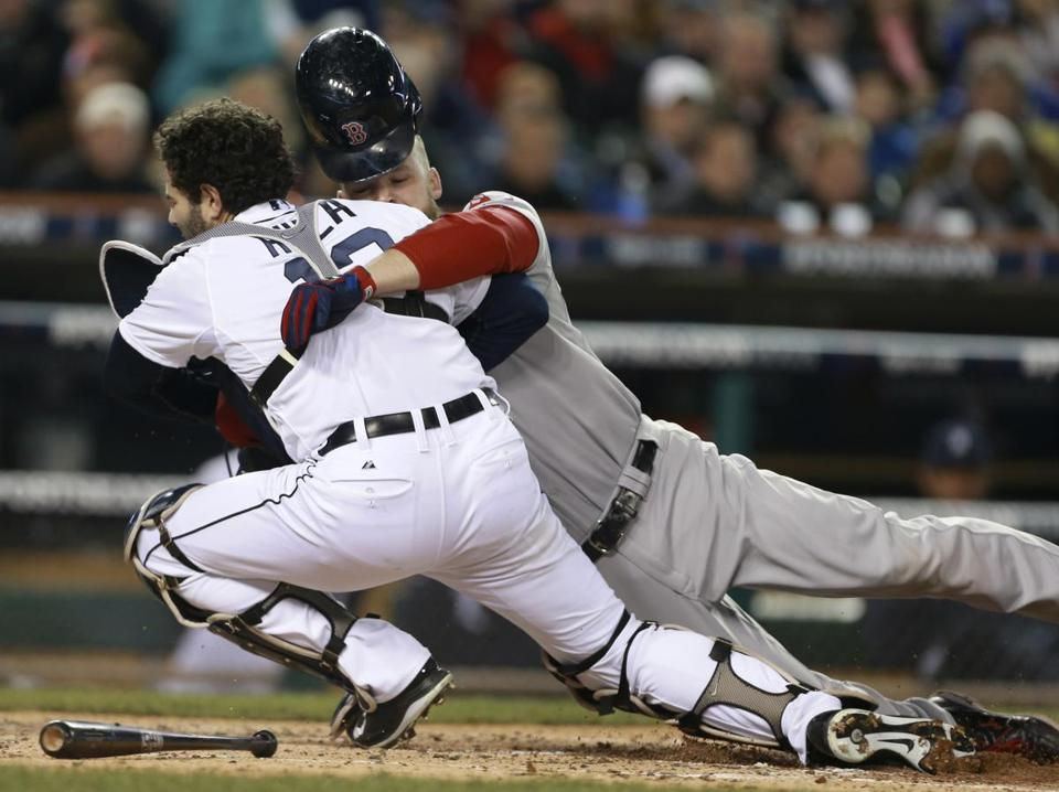 David Ross was out at home but the collision eventually took Tigers catcher Alex Avila out of the game.