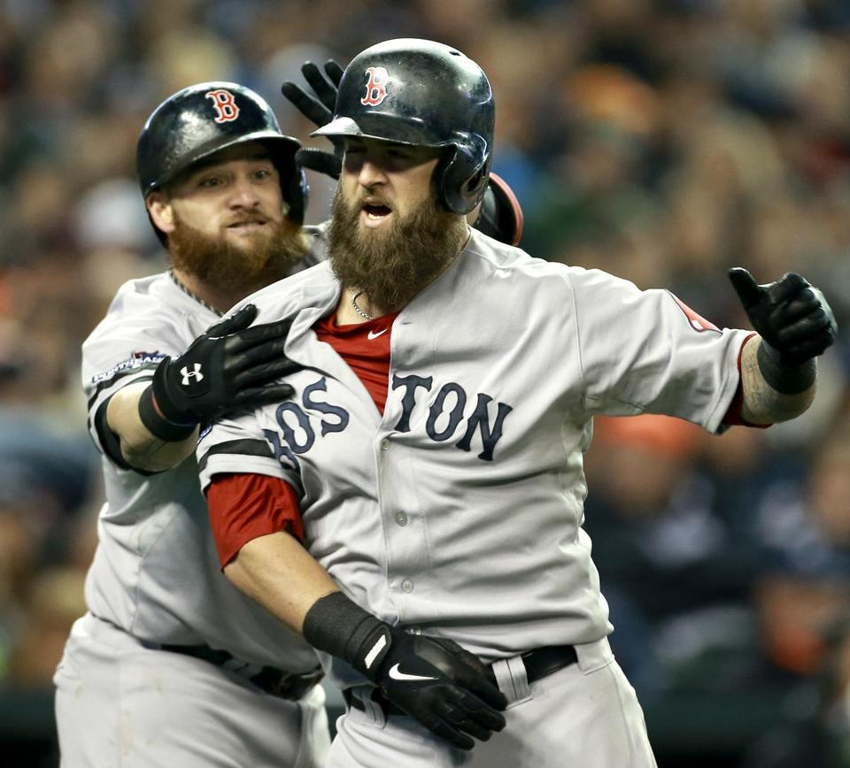 Mike Napoli tried, unsuccessfully, to avoid a beard grab attempt by Jonny Gomes.
