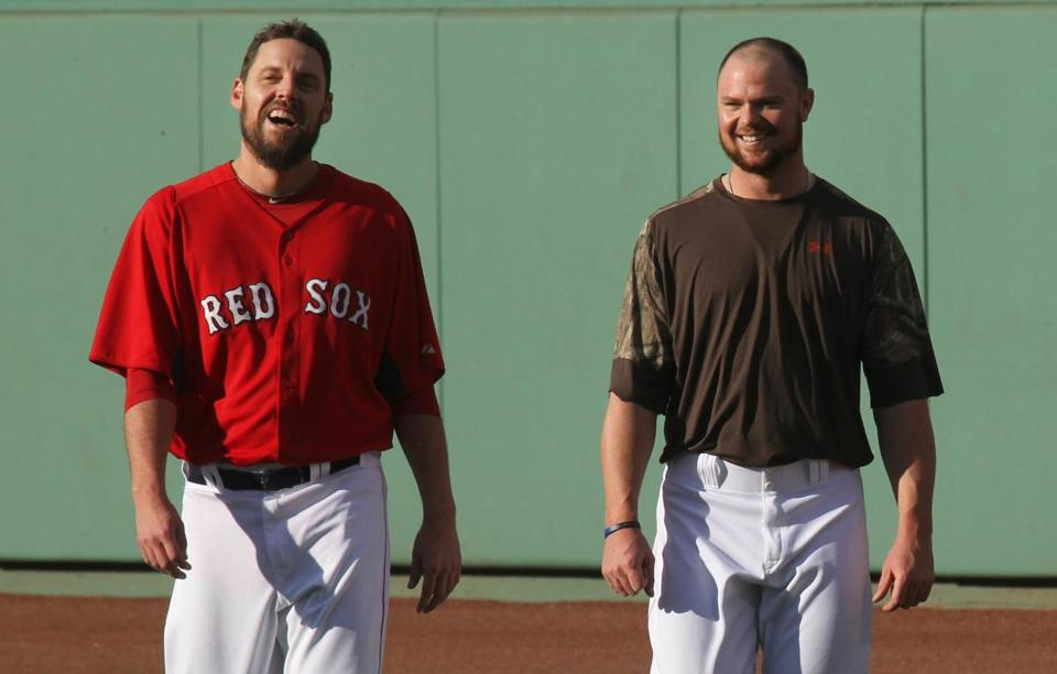 Boston, MA 10-18-13 - Fenway Park - John Lackey and Jon Lester exercise in outfield. The Boston Red Sox practice before game 6 of the ALCS tomorrow at Fenway Park. (Bill Greene / Globe staff) section: sports