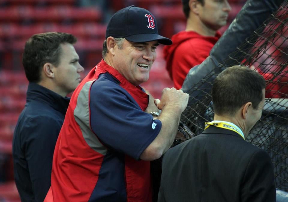 After four one-run games in the ALCS, John Farrell (with GM Ben Cherington in the background) enjoys a laugh Friday.
