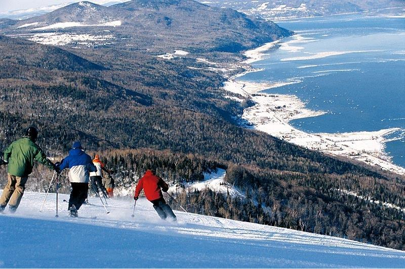 Skiers can take in grand views of the St. Lawrence at Le Massif, a resort purchased by cofounder Daniel Gauthier in 2002.