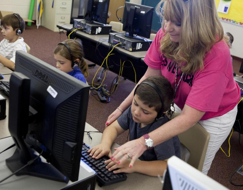 Second-grade teacher Kimberly Blackert helped Cody Simpson with his touch typing at Horseshoe Trails Elementary School in Phoenix.