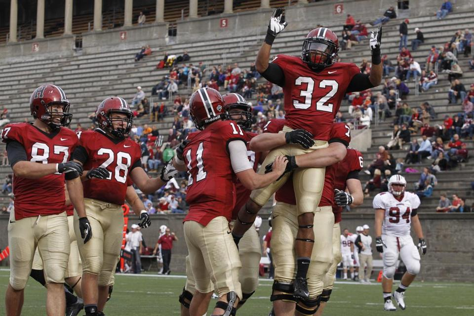Wide receiver Andrew Fischer (32) was lifted in celebration after a touchdown against Lafayette.