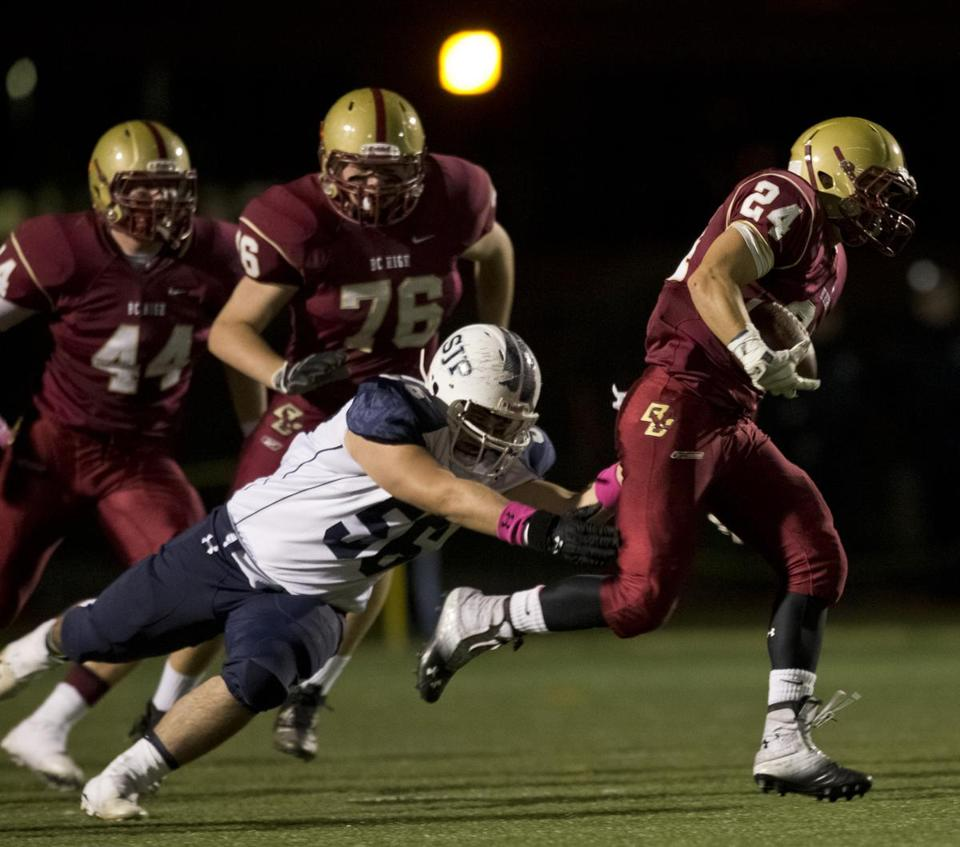 BC High's Robert Harnais goes for a long gain, although he hurt his hamstring on the play.