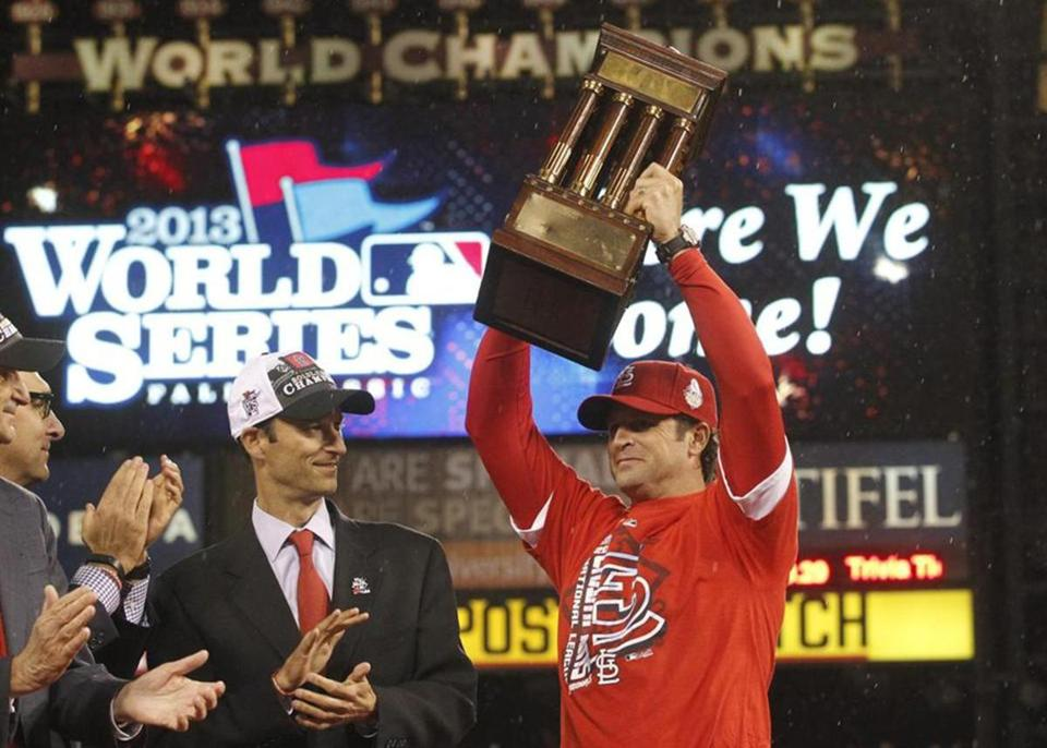 Cardinals manager Mike Matheny held up the National League Championship Trophy after St. Louis beat the Dodgers in Game 6 and advanced to the World Series.