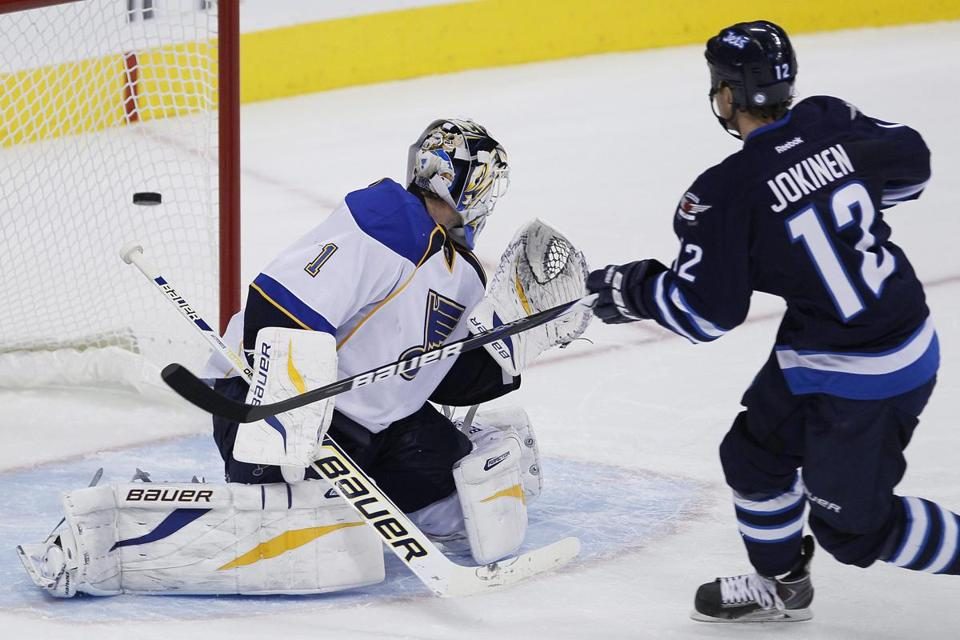 Jets forward Olli Jokinen beat Blues goalie Brian Elliott during Friday's shootout.