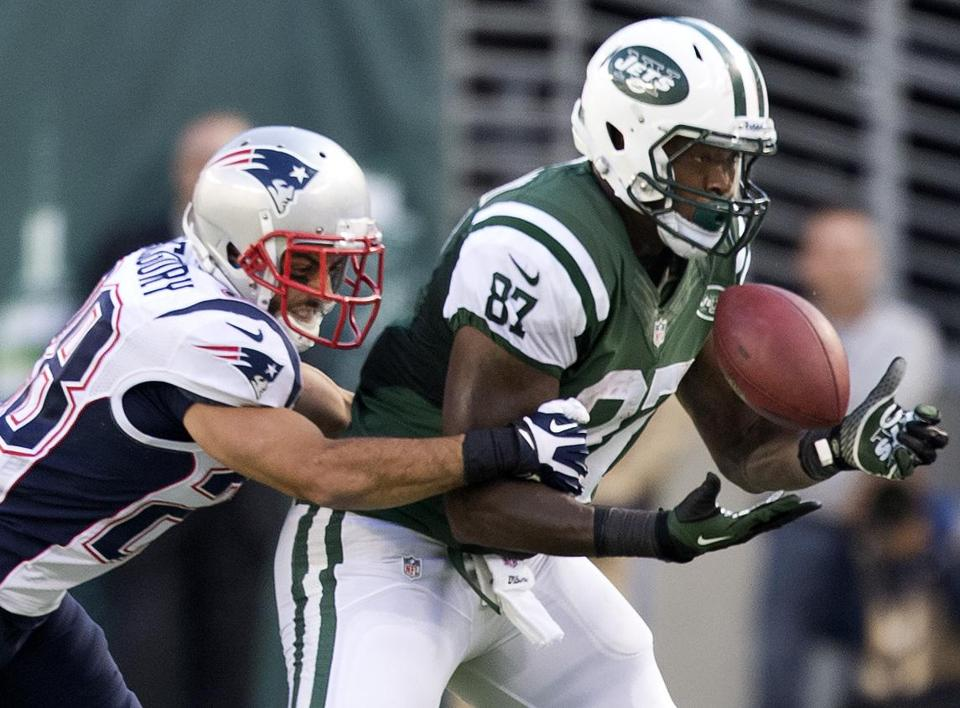 The Patriots' Steve Gregory put pressure on Jets receiver Jeff Cumberland for an incomplete pass in the second half.
