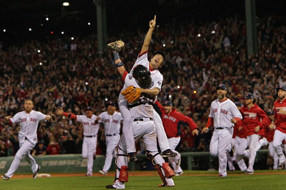 With the last out of the ALCS in the books, closer (and series MVP) Koji Uehara celebrates with catcher Jarrod Saltalamacchia as the rest of the Red Sox rush to get in on the fun.