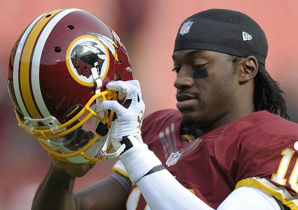 Washington Redskins quarterback Robert Griffin III prepared for a game against the Philadelphia Eagles on Sept. 9.