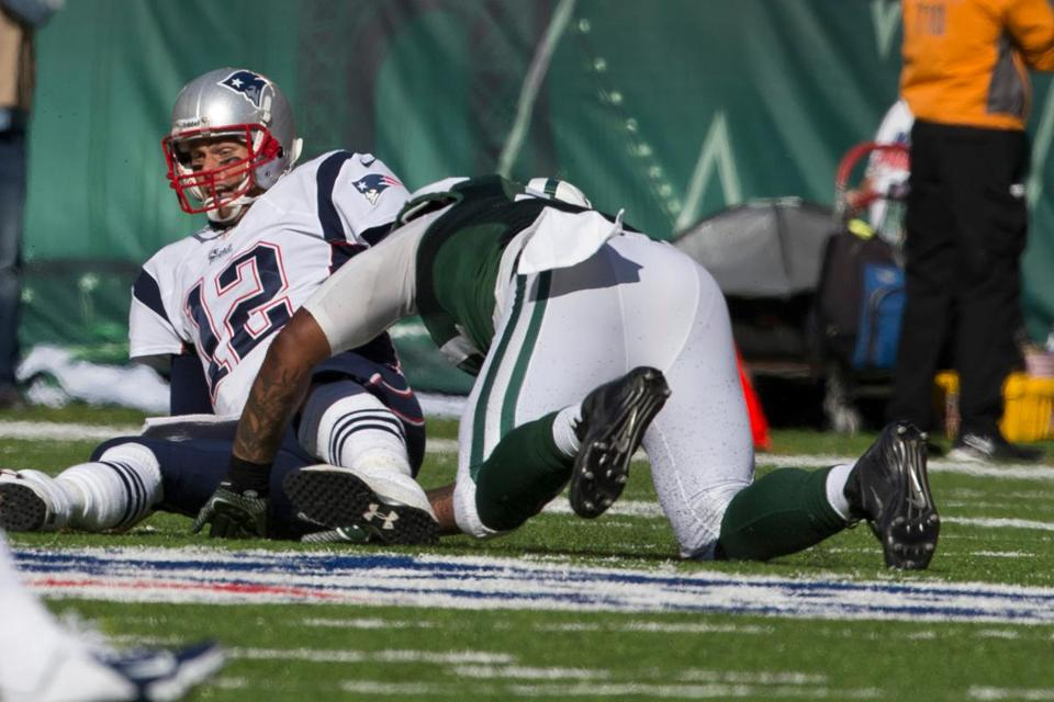 Tom Brady fumbles after being sacked by Calvin Pace, but the Patriots retained possession.