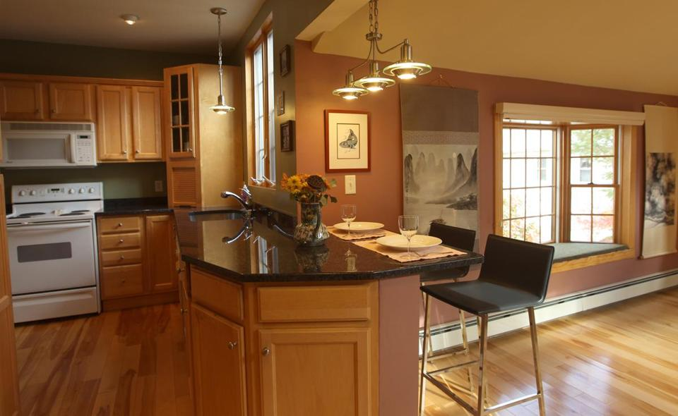 Maple was used for the cabinets and floor in the updated kitchen.