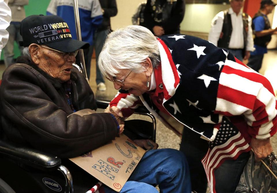 World War II veteran Phillip Coon greeted  Sonja Gilmore during the ceremony at the airport in Tulsa, Okla., on Monday.