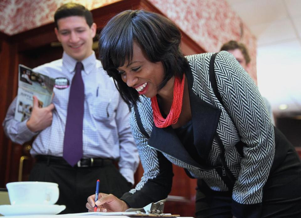 City Council at-large candidate Ayanna Pressley signed in at the Harry Truman Rally Breakfast at West Roxbury Pub and Restaurant.